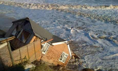 A house fell into the sea in Hemsby, Norfolk, after the combined storm and tidal surge swept away the underside of the cliff it was perched on.