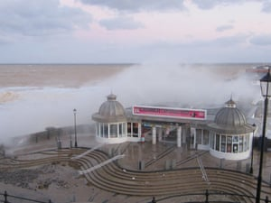 Cromer Pier was still taking a battering this morning after the worst tidal surge for more than 60 years hit coastal towns along the east coast of Britain.