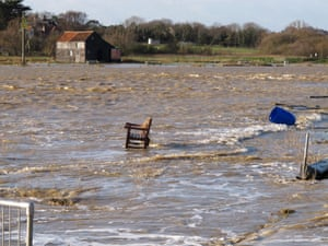 A park bench is surrounded by flood water on the edge of Southwold's harbour in Suffolk.