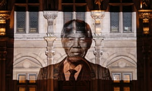 A photograph of former President Nelson Mandela is projected on the facade of the Paris town hall in tribute to his memory.