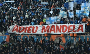 Marseille's football fans hold a banner reading Farewell Mandela before the start of the French L1 football match between Olympique of Marseille and Nantes at the Velodrome stadium in Marseille.