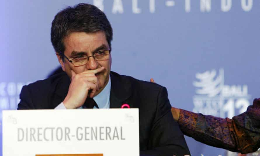 An emotional Roberto Azevedo is comforted during the closing ceremony of the WTO talks.