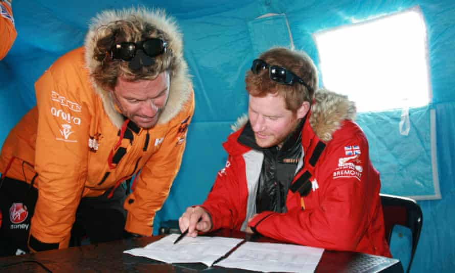 Prince Harry with a team member before the suspension of the race.