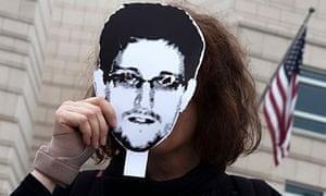 Woman holds Edward Snowden portrait outside US embassy, Berlin 4/7/13