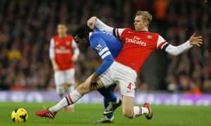 Arsenal's Per Mertesacker attempts to take the ball from Everton's Romelu Lukaku.