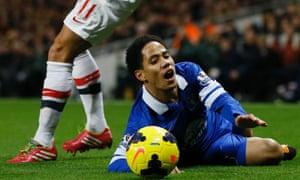 Everton's Steven Pienaar goes down.