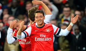 Arsenal celebrate going 1-0 ahead.