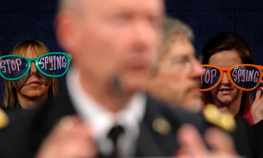 Protesters listen as National Security Agency director general Keith Alexander testifies on Capitol Hill last October.