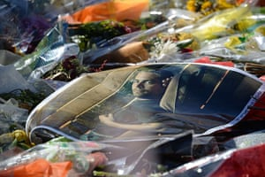 Paul Walker memorial: A poster of actor Paul Walker lies on top of flowers and other mementos lef