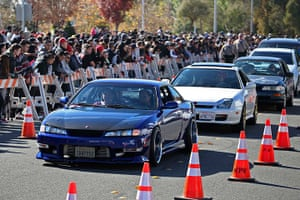 Paul Walker memorial: Vehicles are driven past a crowd attending an unofficial memorial event in