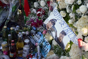Paul Walker memorial: Photos, mementos and bottles of beer are placed at a makeshift memorial