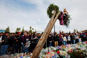 Paul Walker memorial: Fans surround the remains of a tree at the site of the car crash