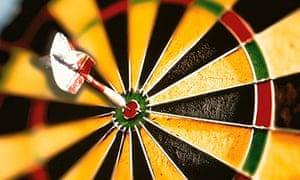 A dart in the bullseye of a dartboard