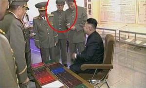 A still taken from the documentary 'The Great Comrade', originally broadcast on North Korean state broadcaster KCTV on October 7 2013, shows uncle of North Korean leader Kim Jong-un, Jang Song-Thaek (in the red circle at left).
