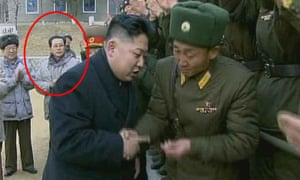 Another still from the documentary, originally showing Jang Song-Thaek in the background (circled) as his nephew meets with military personnel.