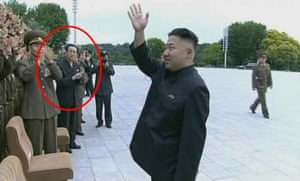 An original still from the documentary shows Kim Jong-un waving to officials and military personnel, while his uncle (circled) looks on.