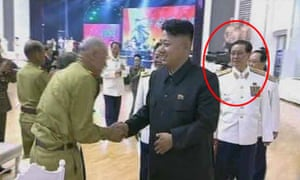 The North Korean leader shakes hands during a visit, accompanied by his uncle (circled).