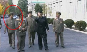 Kim Jong-un tours a building with members of his staff in a scene from the original broadcast, including his uncle (circled).