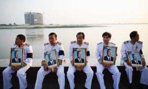 Officials hold portraits of Cambodia's late former King Norodom Sihanouk as his funeral procession begins at the Royal Palace in Phnom Penh. Sihanouk died at age 89 of heart failure last October and his body will cremated on February 4.