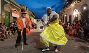 A Uruguayan carnival group dance during the Llamadas parade in Montevideo. The carnival dates back to the country's colonial period and started as a parade of slaves through the city.