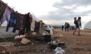 Syrian refugees are seen in a refugee camp on the Syrian side of the border with Turkey, near Idlib.