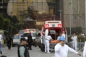 Mexico explosion: Paramedics treat injured people in ambulances outside the building
