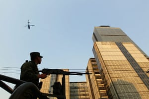 Mexico explosion: The Mexican army guard the Pemex building