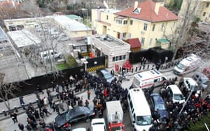 Police and forensic experts at the site of a blast outside the US Embassy in Ankara on 1 February 2013.