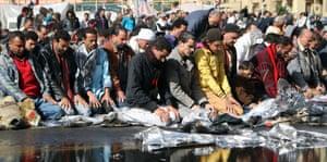 Protesters opposing Egyptian president Mohamed Morsi attend Friday prayers at Tahrir Square in Cairo on 1 February 2013.