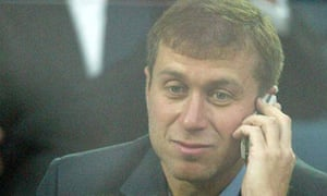 Roman Abramovich on a mobile phone