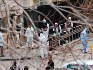 Turkish police forensic experts inspect the site after an explosion at the entrance of the US embassy in Ankara. A suspected suicide bomber is believed to have detonated a device killing himself and one other person, officials said. Read our latest report.