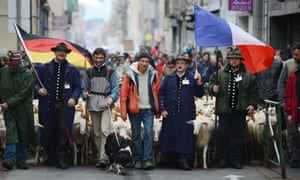 French and German shephards demonstrate with a herd of sheep in Valence, southeastern France. They are protesting over the mandatory tracking of all of their animals with electronic chips after new European Union legislation passed to impose this on all animals born since 2010.