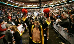A man dressed as Rocky Balboa (the clue's on his shorts) parades around the venue during WIP's Wing Bowl 21 eating contest in Philadelphia. James 'The Bear' McDonald of Granby, Connecticut won with 287 chicken wings. Like I said earlier...it's a mad world.