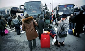 Bulgarians wait to board international coaches departing Sofia central bus station