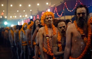 Maha Kumbh : Sadhus wait in line as they prepare to take a bath in the waters at Sangam