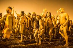 Maha Kumbh : Naked sadhus walk in procession to bathe on the banks of Sangam
