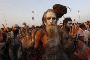 Maha Kumbh : Naked sadhus have their skin painted with ashes for the ritual bath
