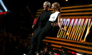 Comedian Ellen DeGeneres and singer Beyoncé appear on stage at the e 55th Grammy awards.