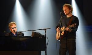 Elton John and Ed Sheeran perform at the 2013 Grammy awards in Los Angeles.