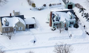 People dig out after very heavy snowfall near Hamden, Connecticut, in the aftermath of a storm that hit the state and much of New England.