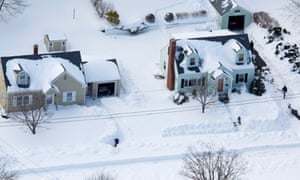 People dig out from a very heavy snowfall, near Hamden, Connecticut, in the aftermath of a storm that hit the state and much of the New England.