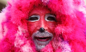 In the pink: a man celebrates in the traditional Rose Monday carnival parade in the German city of Duesseldorf. The Rose Monday parades in Cologne, Mainz and Duesseldorf are the highlight of the German street carnival season.