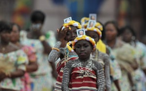 pope benedict resigns: Children attend a mass at by Pope Benedict XVI in Cotonou, Benin