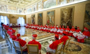 Cardinals listen to the Pope this morning.