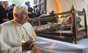 Pope Benedict XVI stands by the remains of Pope Celestine V in 2009.