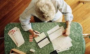 Elderly woman doing her accounts