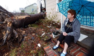 Hellen Chmiel sits in front of the remains of her home in Hattiesburg, Mississippi, following a Sunday afternoon tornado that caused much damage throughout the south Mississippi college town. Chmiel, who was out of her house when the tornado struck, said the large pine tree in the front yard has completely destroyed her bedroom.