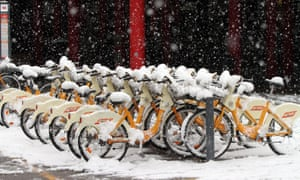 Bikes covered with snow stand in Cadorna square, Milan, Italy. Weather forecasts predict snow even in lower lying areas for 12 February in Italy, as a cold front from northern Europe reaches over to southern Europe.
