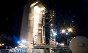 The launch pad tower is rolled back to reveal the ULA Atlas-V rocket with the Landsat Data Continuity Mission (LDCM) spacecraft onboard at Vandenberg Air Force Base, California.