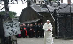 """FILE - In this May 28, 2006 file photo, Pope Benedict XVI walks through the gate of the former Nazi concentration camp Auschwitz in Oswiecim, Poland, to pay his respects to the Holocaust victims. Sign at left reads """"stop"""" in German and Polish. Sign above the gate reads """"Arbeit macht frei,"""" German for """"work will set you free."""" Declaring that he lacks the strength to do his job, Benedict announced Monday Feb. 11, 2013, he will resign Feb. 28 _ becoming the first pontiff to step down in 600 years. (AP Photo/Diether Endlicher) pontiff;religiouis;leader;walking;""""full length""""visit capm building yearend2006trip"""
